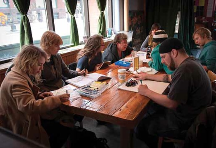 Artists' drawing circle in the Black Dog Coffee and Wine Bar. Almost all of the artists pictured contributed artwork to this Almanac.