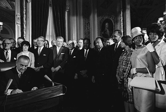 Presiden Lyndon Johnson signs the Voting Rights Act of 1965