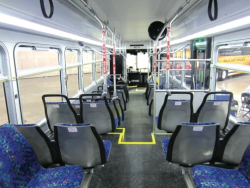 The interior of Metro Transit bus number 1300, built in 2011, seen from the back seat. © Jaron McNamara/TheTransitCamera on Flickr