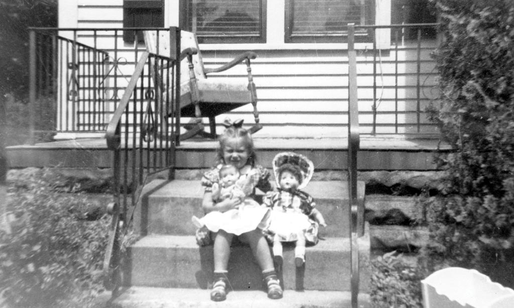 Marianne as a little girl, on the porch of her grandmother's Roblyn Avenue home. (Photo courtesy Marianne McNamara)
