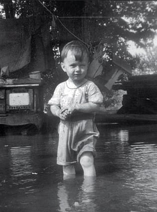 Matthew at the beach . . . actually his front yard during spring flooding of the Mississippi River in 1946 © Mathew Van Tassell