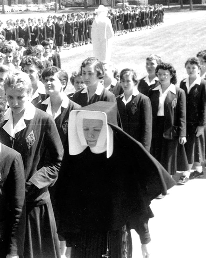 A procession on the grounds of Our Lady of Peace High School