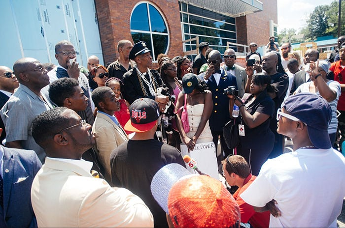 Wikipedia photo. Protesters gather outside the Ferguson Police Department