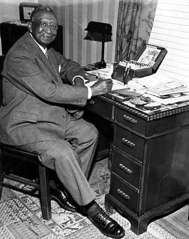 Frank Boyd in his home on Mackubin Avenue, St. Paul, 1951; Secretary Treasurer of the B.S.C.P. (Brotherhood of Sleeping Car Porters).