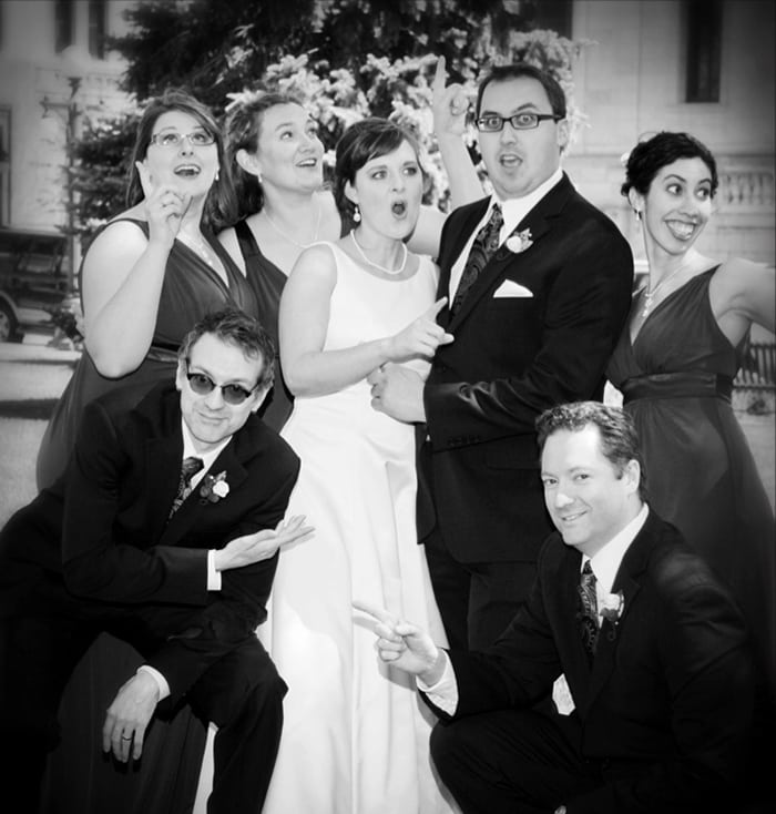 Sarah Roberts Delacueva, Brian Peterson Delacueva, and their wedding party. Photo courtesy of Michael Murray